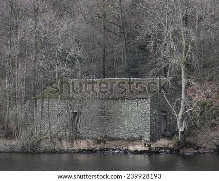 rock house near river - stock photo