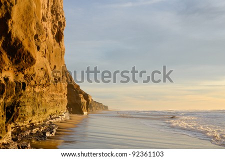 Rock in the Waves at Dusk - stock photo