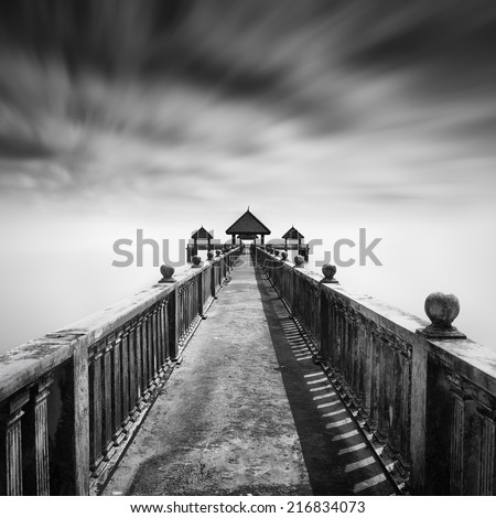 Rock Jetty in black and white .slightly motion blur at sky  - stock photo