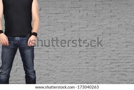 rock men standing on brick wall background - stock photo