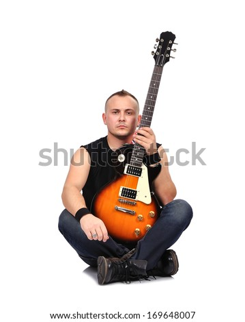 rock musician sitting with electrical guitar - stock photo