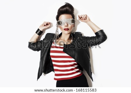 rock n roll woman in glasses and black jacket - stock photo