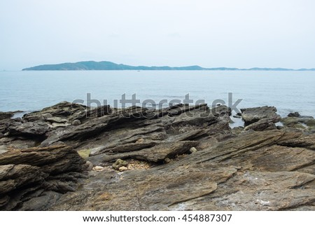 Rock on sea coastline with seascape view at Mu Ko Samet National Park in the Gulf of Thailand. - stock photo