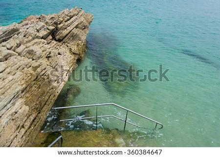 Rock on the beach (San Sebastian - Spain) - stock photo
