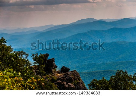 Rock outcrop on North Marshall and view of the Blue Ridge in Shenandoah National Park, Virginia. - stock photo