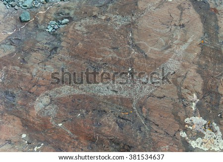 Rock paintings of ancient nomads of Central Asia - stock photo