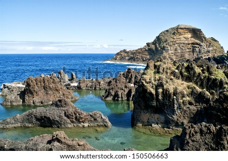rock pools on the seafront in Madeira Island - stock photo