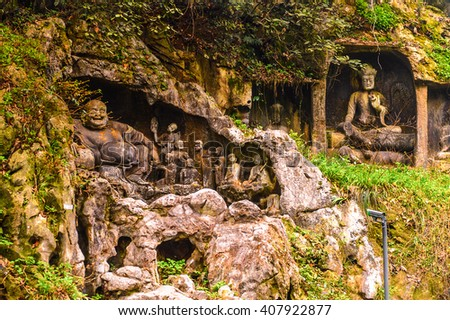 Rock reliefs at Feilai Feng at the Lingyin Temple (Temple of the Soul's Retreat) complex. One of the largest Buddhist temples in China - stock photo