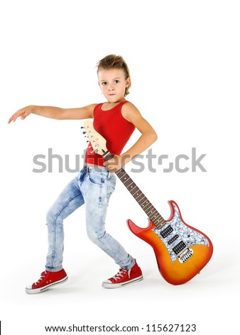 Rock star kid with electric guitar - stock photo