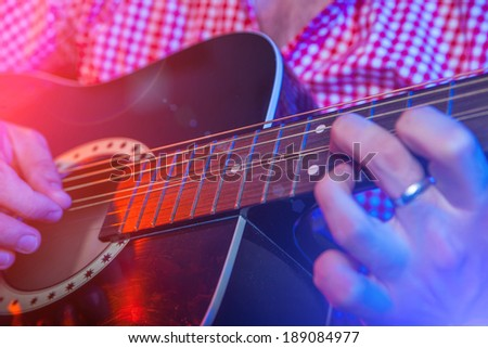 Rock star Playing Live solo on Guitar - stock photo