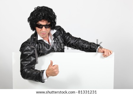 Rock-star with a white board - stock photo