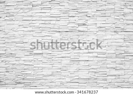 Rock stone brick tile wall aged texture detailed pattern background in light white grey brown color tone: Grunge ancient rustic limestone patterned backdrop for decoration in gray toned colour - stock photo