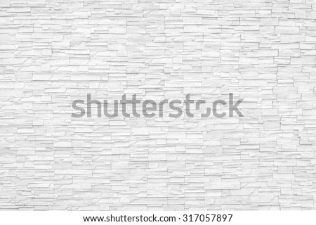 Rock stone brick tile wall aged texture detailed pattern background in white grey color tone: Grunge ancient rustic limestone patterned backdrop for decoration in white gray toned colour - stock photo