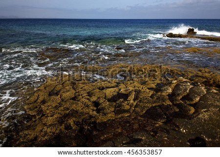 rock stone sky cloud beach  water  musk pond  coastline and summer in lanzarote spain  - stock photo