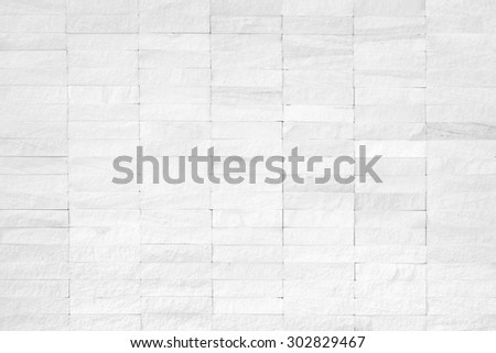 Rock stone tile wall texture rough patterned background in white color tone: Limestone finishing textured backdrop for interior decoration and design in light white grey toned colour - stock photo