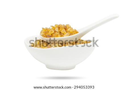 Rock sugar from sugar cane in white spoon & cup isolated on white background with clipping path. - stock photo