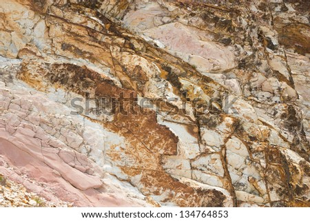 Rock texture from sea erosion - stock photo