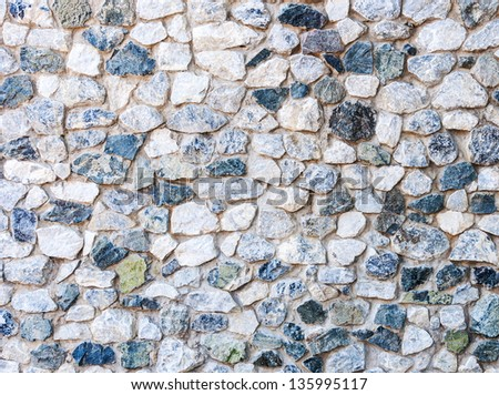 Rock wall of the public toilet in countryside of Thailand. - stock photo
