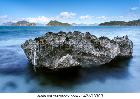 Rock washed by the sea - stock photo
