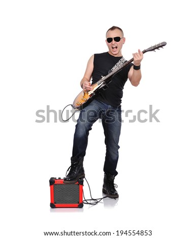 rocker with electrical guitar and guitar combo - stock photo