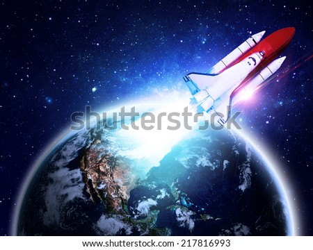Rocket Blasting Off From Earth - Elements of this Image Furnished By NASA - stock photo
