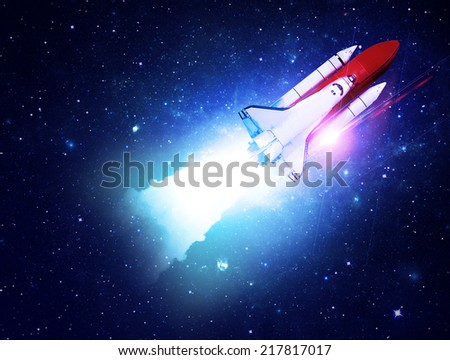 Rocket Blasting Through Starfield - Elements of this Image Furnished By NASA - stock photo