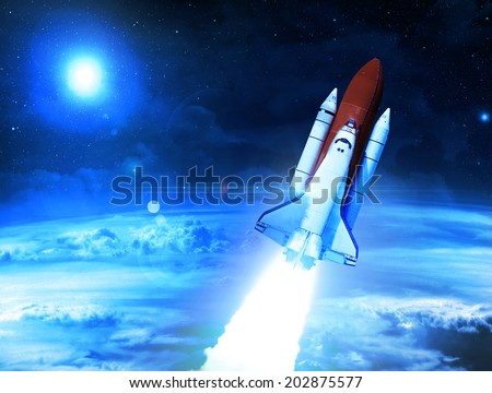 Rocket Leaving Planet Earth - Elements of this Image Furnished By NASA - stock photo