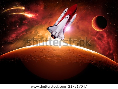 Rocket to Mars - Elements of this Image Furnished By NASA - stock photo
