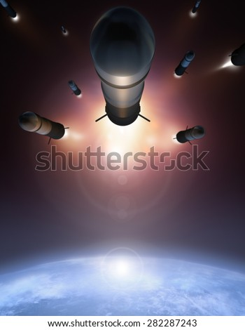 Rockets in the space over Earth - stock photo