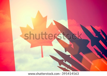 Rockets silhouettes background Canada flag. Toned - stock photo