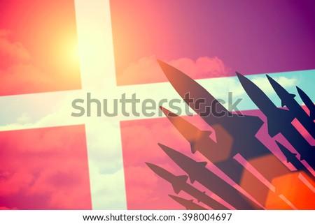 Rockets silhouettes background Denmark flag. Toned - stock photo