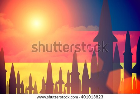 Rockets silhouettes background Germany flag. Toned - stock photo