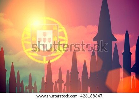 Rockets silhouettes background  Portugal flag. Toned - stock photo