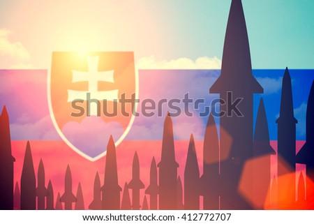 Rockets silhouettes background Slovakia flag. Toned - stock photo