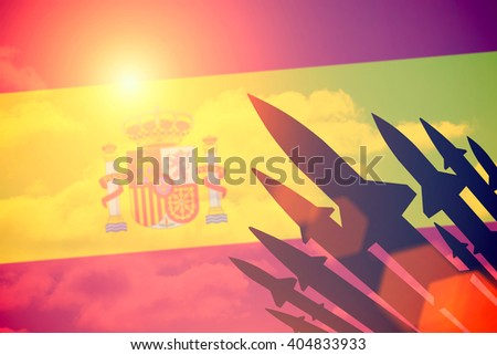 Rockets silhouettes background Spain flag. Toned - stock photo