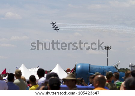 ROCKFORD, IL - JUNE 3: Black Diamond Jet Team demonstrates flying skills and aerobatics at the annual Rockford Airfest on June 3, 2012 in Rockford, IL - stock photo