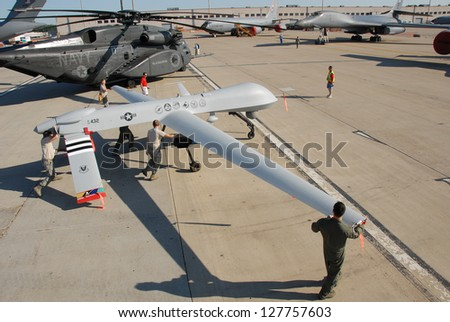 ROCKFORD, IL- JUNE 2: MQ-1 Predator Drone being rolled into position as a static display for the June 2, 2012 at the Rockford AirFest in Rockford, IL. - stock photo