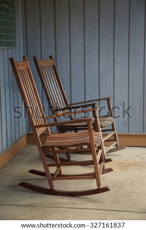 rocking chairs on porch - stock photo