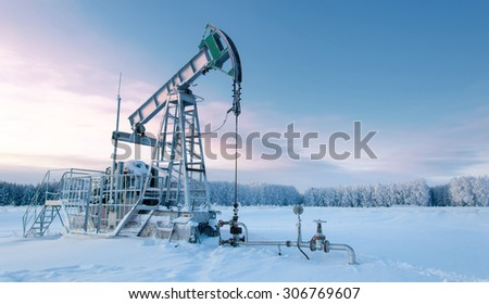 rocking oil. Oil pumps. Oil industry equipment. wheat field - stock photo