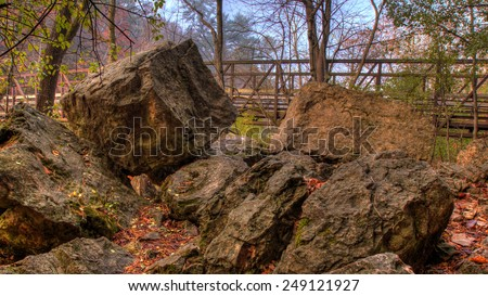 Rocks and Bridge in HDR during Fall colors. - stock photo