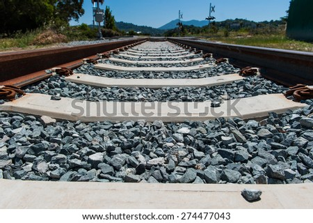 Rocks and cross beams form train track bed - stock photo
