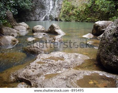 Rocks and La'ie Falls - stock photo