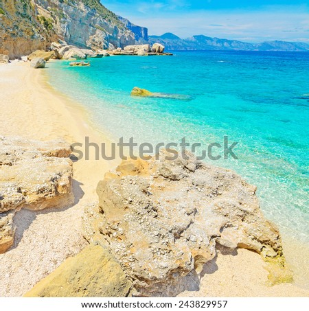 rocks and sand in Cala Mariolu, Sardinia - stock photo