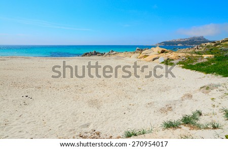 rocks and sand in Santa Reparata beach, sardinia - stock photo