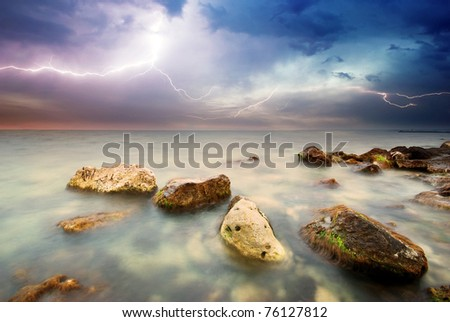 Rocks and sea storm. Dramatic scene. Composition of nature. - stock photo