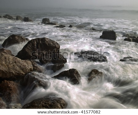 Rocks and surf - stock photo
