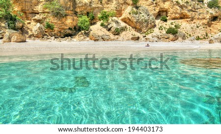 rocks and water in Cala Biriola, Sardinia - stock photo