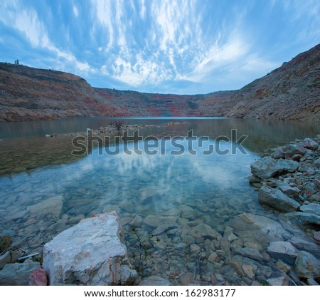 Rocks and water in Quarry - stock photo