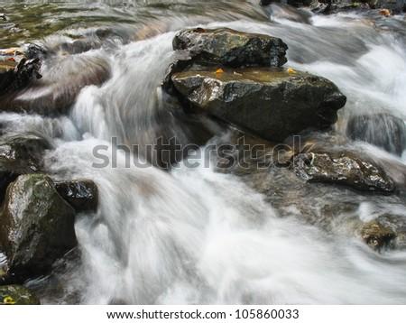 rocks cascade creek - stock photo