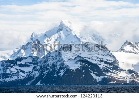 Rocks covered with snow in South Georgia, British overseas territory, Southern Atlantic Ocean. - stock photo